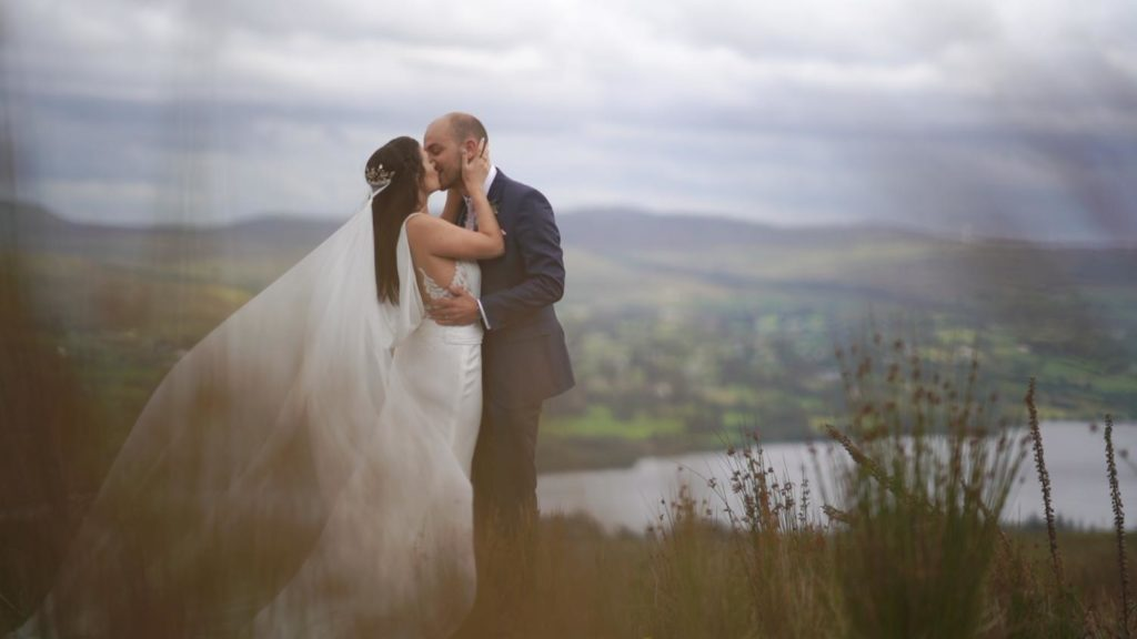 bride groom kiss overlooking lough eske on a mountain harveys point