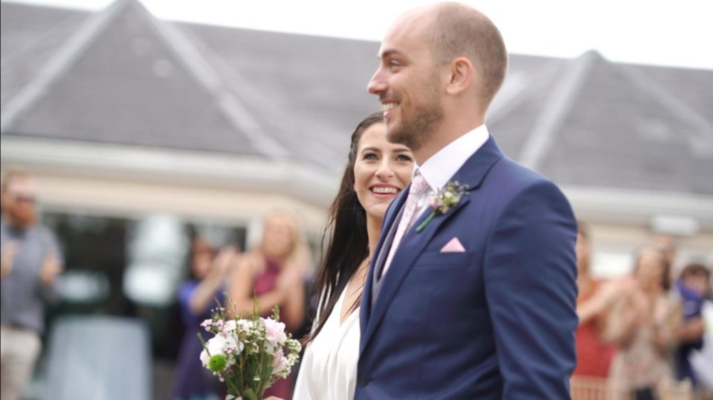 bride and groom couple walk down aisle after ceremony in harvey's point