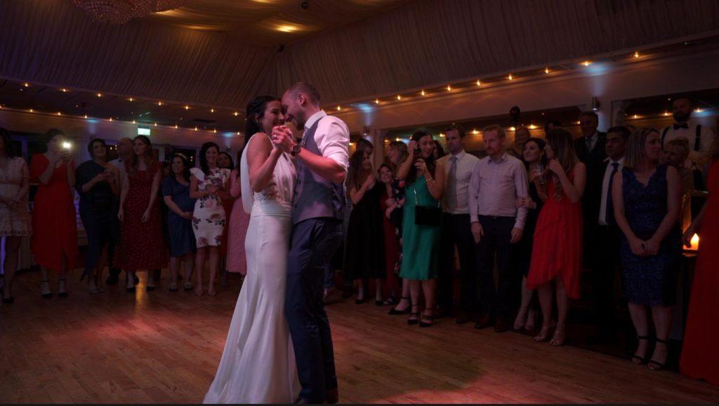 first dance wedding surrounded by friends on harveys dancefloor