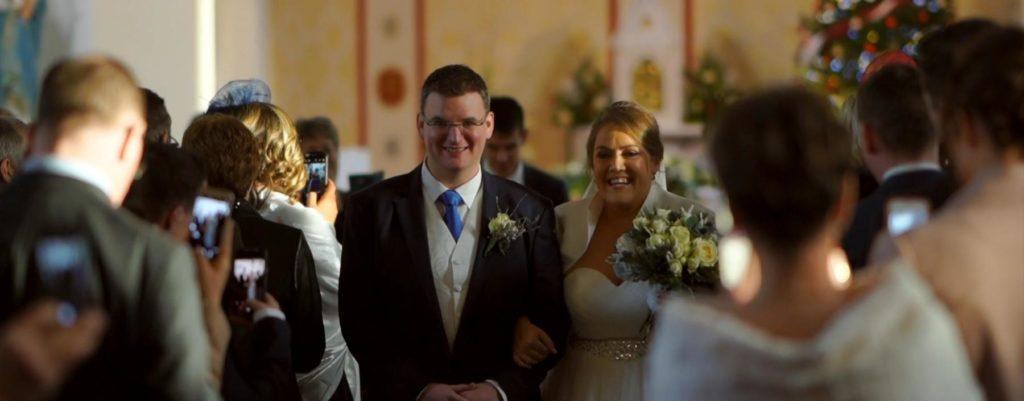walk aisle married couple bride groom guests
