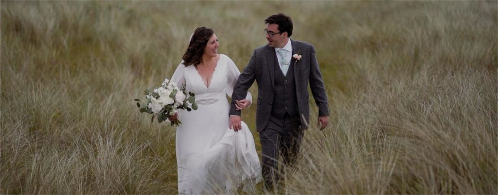 Sand dunes rathmullan beach wedding couple bride and groom walk