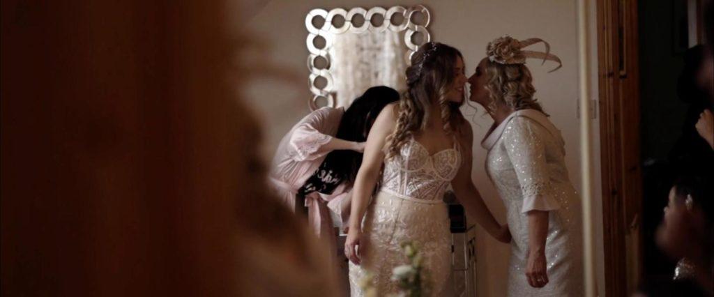 bride mother bridesmaid getting dressed