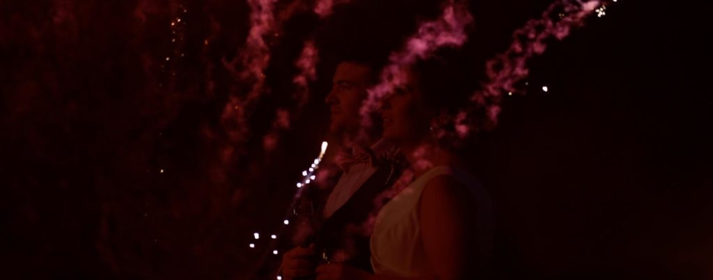 Fireworks bride and groom watch harveys point wedding videographer