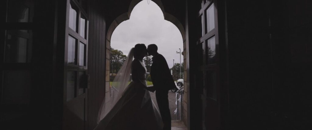 first kiss silhouette before arriving at Mill Park videographer